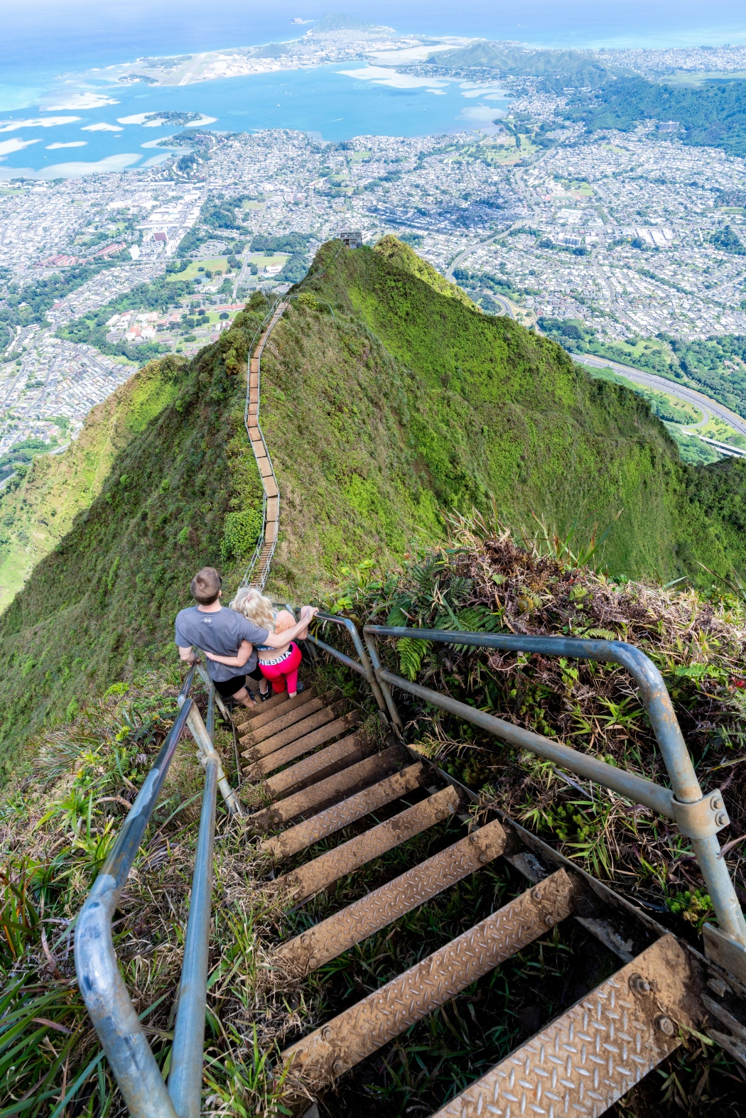 A couple embraces on the Stairway to Heaven on Oahu, Hawaii